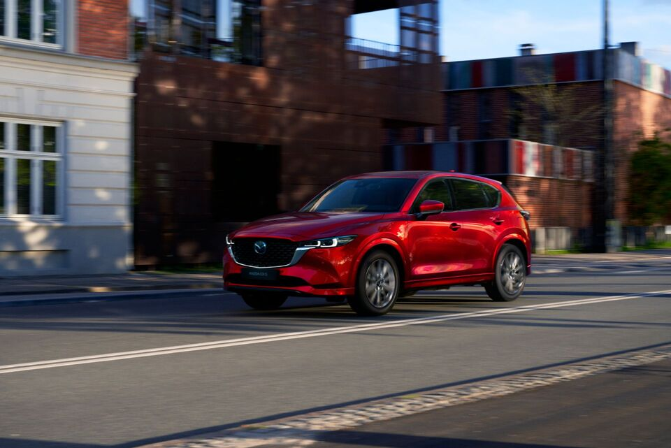 2022-Mazda-CX-5-fron-side-view red car awd
