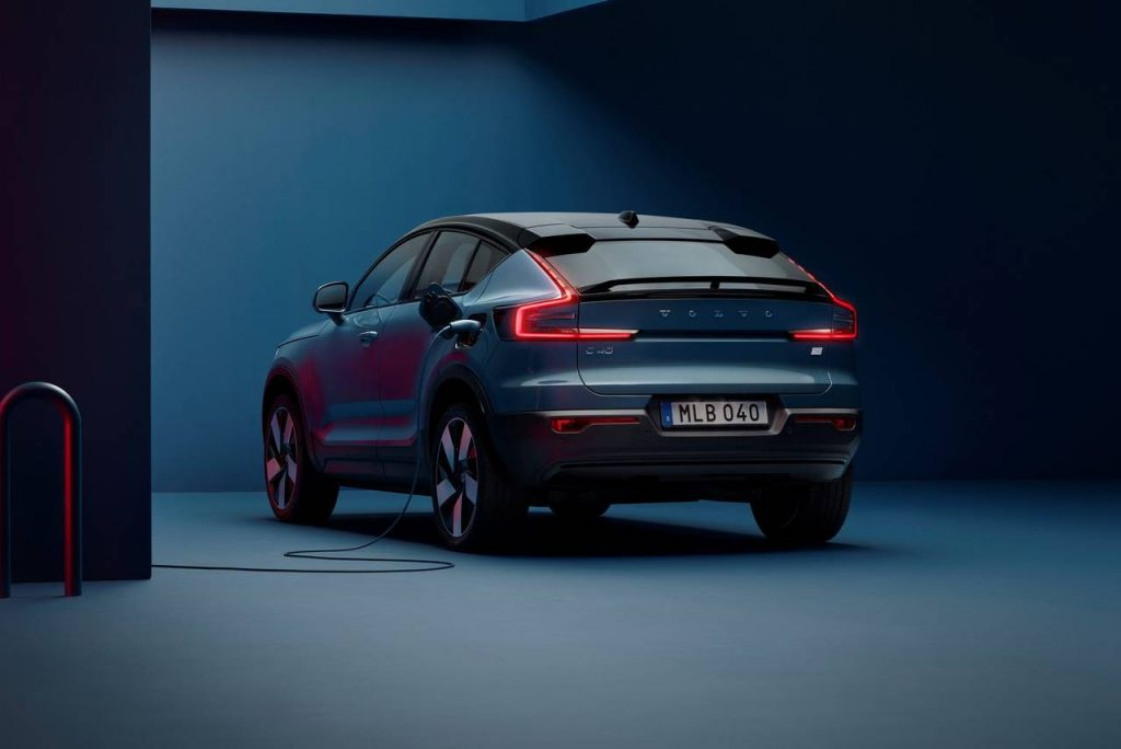 2022 Volvo C40 Recharge EC SUV  rear view with charging station