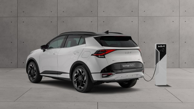 2022 Kia Sportage Hybrid SUV side rear view charging station