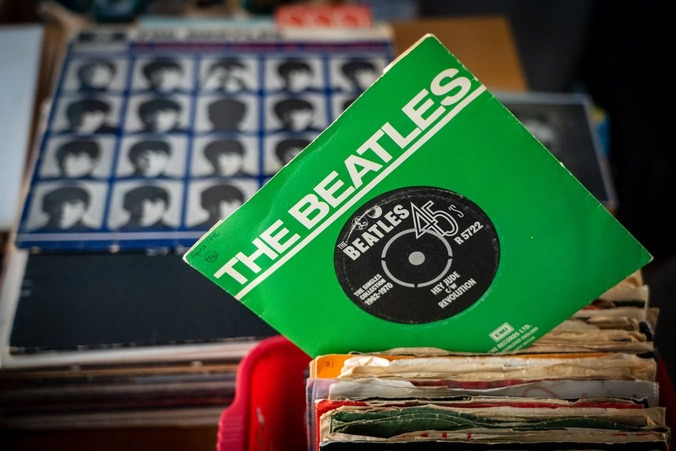 The single Hey Jude, by The Beatles, with the album, A Hard Days Night in the background.